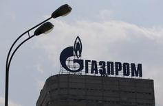 A view shows the company logo of Gazprom company installed on the roof of its office building in Moscow, August 10, 2015. Gazprom, Russia's largest gas producer, posted a 71-percent increase in the first quarter net profit to 382.1 billion roubles ($5.91 billion), the company said on Monday. REUTERS/Maxim Shemetov