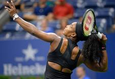 Serena Williams of the United States serves to Vitalia Diatchenko of Russia on day one of the 2015 US Open tennis tournament at USTA Billie Jean King National Tennis Center. Robert Deutsch-USA TODAY Sports  / Reuters