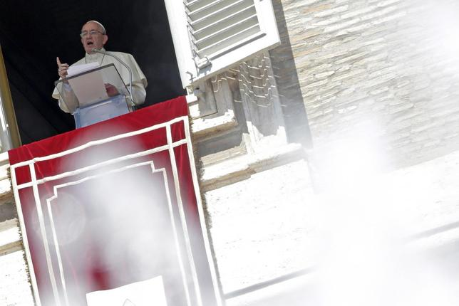 Pope Francis, framed by the water of a fountain, talks from the window during his Sunday Angelus prayer in Saint Peter's square at the Vatican, August 30, 2015. REUTERS/Max Rossi
