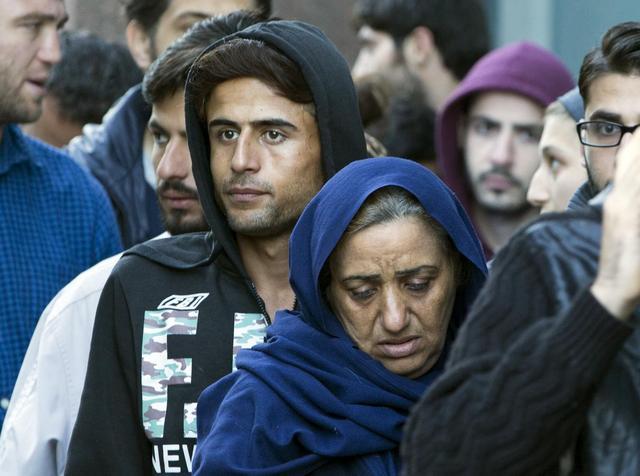 Migrants seeking asylum status queue outside the foreign office in Brussels, Belgium September 2, 2015. REUTERS/Yves Herman