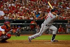 Washington Nationals first baseman Ryan Zimmerman (11) hits a one run double off of St. Louis Cardinals relief pitcher Jonathan Broxton (not pictured) during the eighth inning at Busch Stadium.  Jeff Curry-USA TODAY Sports
