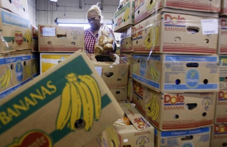 A woman packages donated food at the Los Angeles Regional Food Bank in Los Angeles, April 20, 2009. REUTERS/Lucy Nicholson