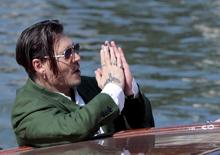 "Actor Johnny Depp waves to fans as he leaves after a photocall for the movie ""Black Mass"" at the 72nd Venice Film Festival in northern Italy September 4, 2015. REUTERS/Manuel Silvestri"