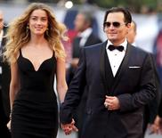 "Actor Johnny Depp and his wife Amber Heard arrive for the red carpet event for the movie ""Black Mass"" at the 72nd Venice Film Festival in northern Italy September 4, 2015.  REUTERS/Stefano Rellandini"