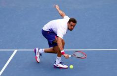 Sep 4, 2015; New York, NY, USA; Marin Cilic of Croatia returns a shot to Mikhail Kukushkin of Kazakhstan on day five of the 2015 U.S. Open tennis tournament at USTA Billie Jean King National Tennis Center. Mandatory Credit: Jerry Lai-USA TODAY Sports
