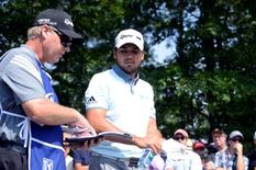 Sep 4, 2015; Norton, MA, USA; Jason Day and his caddie discuss how to recover from an errant  tee shot on the 18th hole during the first round at the Deutsche Bank TPC of Boston. Mandatory Credit: Mark Konezny-USA TODAY Sports