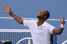 Donald Young  of the United States celebrates his five set win over Viktor Troicki of Serbia on day six of the 2015 U.S. Open tennis tournament at USTA Billie Jean King National Tennis Center. Anthony Gruppuso-USA TODAY Sports  / Reuters