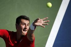 Bernard Tomic of Australia serves to Richard Gasquet of France during their match at the U.S. Open Championships tennis tournament in New York, September 5, 2015. REUTERS/Mike Segar
