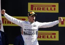 Mercedes Formula One driver Lewis Hamilton of Britain celebrates his victory in the Italian F1 Grand Prix in Monza, northern Italy September 6, 2015. REUTERS/Giampiero Sposito