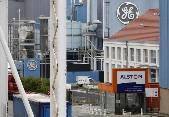 The logos of French power and transport engineering company Alstom and U.S. conglomerate General Electric are pictured on their site in Belfort, June 23, 2014. REUTERS/Vincent Kessler