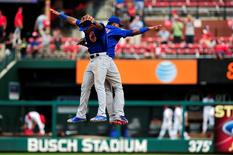 Sep 7, 2015; St. Louis, MO, USA; Chicago Cubs shortstop Addison Russell (22) and second baseman Starlin Castro (13) celebrate after defeating the St. Louis Cardinals 9-0 at Busch Stadium. Mandatory Credit: Jeff Curry-USA TODAY Sports