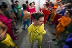 A group of people wearing full solid-coloured bodysuits are seen after taking part in a street art performance in Bat Yam, near Tel Aviv, Israel August 29, 2015. REUTERS/Amir Cohen