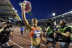 Dafne Schippers of Netherland reacts after winning the women's 200 metres during the IAAF Diamond League athletics meeting, also known as Memorial Van Damme, in Brussels September 11, 2015. REUTERS/Eric Vidal