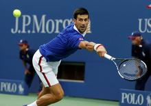 Novak Djokovic of Serbia returns volley to Marin Cilic of Croatia during their men's singles semi-final match at the U.S. Open Championships tennis tournament in New York, September 11, 2015. REUTERS/Shannon Stapleton