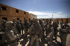 U.S. Marines from Fox Company, 2nd Battalion 1st Marines, 13th Marine Expeditionary Unit debrief during a non-live fire Military Operations in Urban Terrain (MOUT) training at US Marine Corps: Marines Air Ground Combat Center in Twentynine Palms, California September 1, 2015. REUTERS/Mario Anzuoni