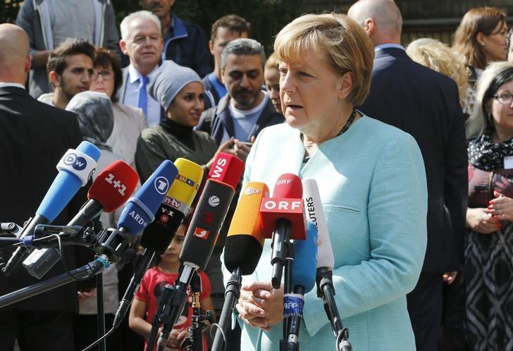 German Chancellor Angela Merkel gives a statement after her visit to a refugee camp near the Federal Office for Migration and Refugees at Berlin's Spandau district, Germany, September 10, 2015. REUTERS/Fabrizio Bensch