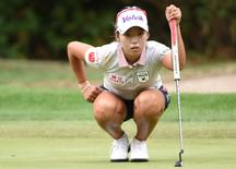 Aug 20, 2015; Coquitlam, British Columbia, CAN; Mi Hyang Lee eyes the green before putting during the first round at Vancouver Golf Club. Mandatory Credit: Anne-Marie Sorvin-USA TODAY Sports