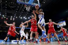 France's Tony Parker goes for the basket against Turkey's Semih Erden during their 2015 EuroBasket 2015 round of 16 match at the Pierre Mauroy stadium in Villeneuve d'Ascq near Lille, France, September 12, 2015. REUTERS/Benoit Tessier