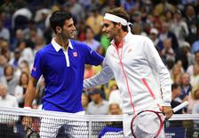 Sep 13, 2015; New York, NY, USA; Novak Djokovic of Serbia greets Roger Federer of Switzerland before the Men's Singles Final on day fourteen of the 2015 U.S. Open tennis tournament at USTA Billie Jean King National Tennis Center. Mandatory Credit: Robert Deutsch-USA TODAY Sports