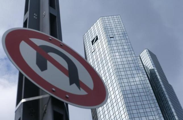 A 'No U-turn' traffic sign stands in front of Deutsche Bank headquarters in Frankfurt, Germany June 9, 2015. REUTERS/Ralph Orlowski
