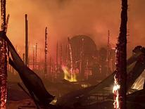 "The Full Throttle Saloon, which billed itself as the ""world's largest biker bar,"" is seen reduced to burning embers following an early morning fire in Sturgis, South Dakota September 8, 2015, in this handout courtesy of the Sturgis Volunteer Fire Department. REUTERS/Sturgis Volunteer Fire Department/Handout via Reuters"