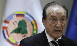 Eugenio Figueredo gives his first news conference since taking charge after the resignation of former President Nicolas Leoz, in Asuncion April 30, 2013. REUTERS/Jorge Adorno