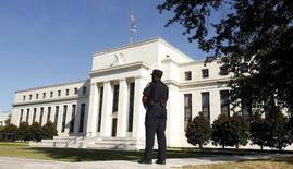 A Federal Reserve police officer keeps watch while posted outside the Federal Reserve headquarters in Washington September 16, 2015. REUTERS/Kevin Lamarque