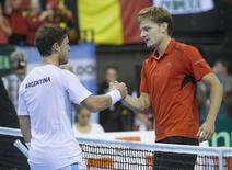 Argentina's Diego Schwartzman (L) shakes hands with Belgium's David Goffin after their semi-final match of the Davis Cup at Forest National arena in Brussels, Belgium September 20, 2015.  REUTERS/Yves Herman