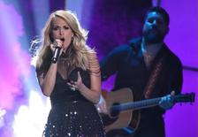 "Carrie Underwood performs ""Little Toy Guns"" during the 2015 CMT Awards in Nashville, Tennessee June 10, 2015. REUTERS/Harrison McClary"