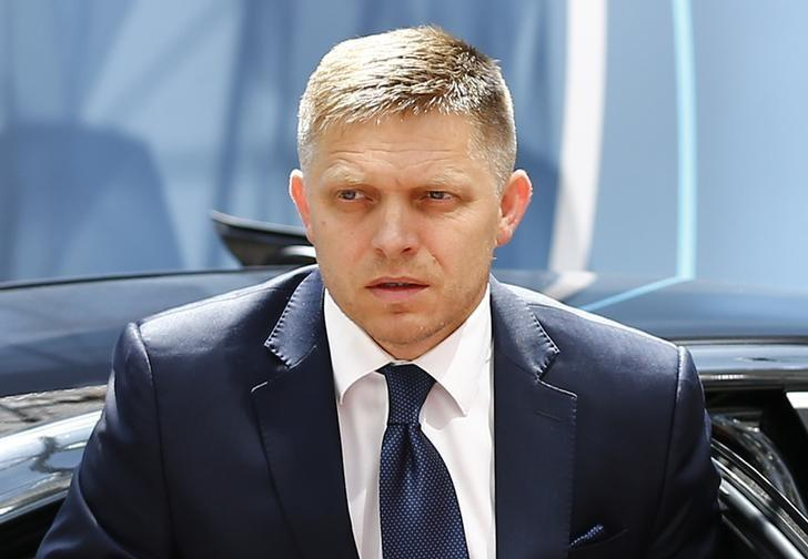 Slovakian Prime Minister Robert Fico arrives at the European Union (EU) Council headquarters at the start of an EU leaders summit in Brussels, Belgium, June 25, 2015.    REUTERS/Darren Staples