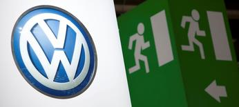 Volkswagen logo is seen next to an emergency exit sign on the company's booth during the first media day of the Geneva Auto Show at the Palexpo in Geneva, in this March 6, 2012 file photo. REUTERS/Valentin Flauraud/Files