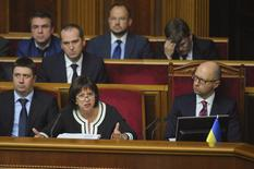 Ukrainian Prime Minister Arseny Yatseniuk (R, front) and Finance Minister Natalia Yaresko (C, front) attend a parliament session in Kiev, Ukraine, September 17, 2015. Ukraine's parliament on Thursday approved three laws needed to pass a debt restructuring deal that the country's international backers have described as essential for its financial stability. REUTERS/Andrew Kravchenko/Pool      TPX IMAGES OF THE DAY           - RTS1K21