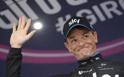 Team Sky's rider Vasil Kiryienka of Belarus celebrates on the podium after winning the 14th stage, a 59.4-km individual time trial, of the 98th Giro d'Italia (Tour of Italy) cycling race from Treviso to Valdobbiadene, Italy, May 23, 2015. REUTERS/LaPresse/Fabio Ferrari