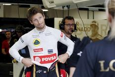 Lotus Formula One driver Romain Grosjean of France reacts in the team garage at the Marina Bay street circuit ahead of the first practice session of the Singapore F1 Grand Prix September 18, 2015. REUTERS/Edgar Su