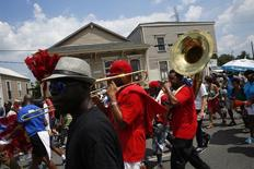 The All For One brass band performs in a second-line parade marking the 10th anniversary of Hurricane Katrina on St. Claude Avenue in New Orleans, Louisiana August 29, 2015.  REUTERS/Edmund D. Fountain