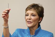 Susan M. Cameron, president and chief executive officer of Reynolds American Inc. holds up her e-cigarette, the VUSE, during a press conference at Reynolds American in Tobaccoville, North Carolina May 23, 2014. REUTERS/Chris Keane