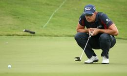 Sep 24, 2015; Atlanta, GA, USA; Henrik Stenson lines up a putt on the first green during the first round of the Tour Championship by Coca-Cola at East Lake Golf Club. Mandatory Credit: Jason Getz-USA TODAY Sports