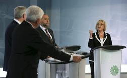 Green Party leader Elizabeth May (R) speaks as Conservative leader and Prime Minister Stephen Harper (L), Bloc Quebecois leader Gilles Duceppe (2nd L) and New Democratic Party leader Thomas Mulcair look on during the French language leaders' debate in Montreal, Quebec September 24, 2015. REUTERS/Christinne Muschi