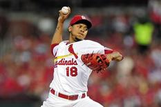 Sep 4, 2015; St. Louis, MO, USA; St. Louis Cardinals starting pitcher Carlos Martinez (18) throws the ball against the Pittsburgh Pirates during the first inning at Busch Stadium. Mandatory Credit: Jeff Curry-USA TODAY Sports