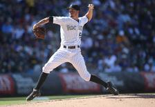 Sep 27, 2015; Denver, CO, USA; Colorado Rockies starting pitcher Chris Rusin (52) delivers a pitch during the third inning against the Los Angeles Dodgers at Coors Field. The Rockies won 12-5. Mandatory Credit: Chris Humphreys-USA TODAY Sports