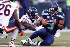 Sep 27, 2015; Seattle, WA, USA; Seattle Seahawks quarterback Russell Wilson (3) slides after scrambling against the Chicago Bears during the fourth quarter at CenturyLink Field. Mandatory Credit: Joe Nicholson-USA TODAY Sports