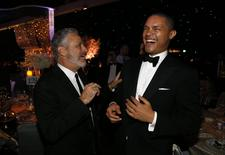 Television personality Jon Stewart (L) talks with actor Trevor Noah at the 67th Annual Primetime Emmy Awards Governors Ball in Los Angeles, California September 20, 2015.  REUTERS/Mario Anzuoni