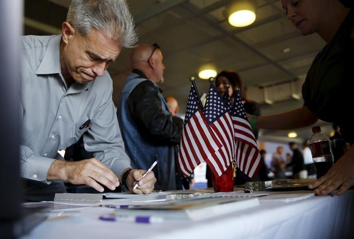 A job seeker fills out papers at a military job fair in San Francisco, California, August 25, 2015. REUTERS/Robert Galbraith/Files