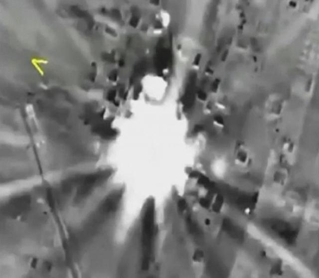 A frame grab taken from video released by the Russian Defence Ministry October 1, 2015, shows Russian jets hitting a target in Syria, which the Kremlin says includes a list of well-known militant organizations and not only Islamic State.  REUTERS/Ministry of Defence of the Russian Federation/Handout