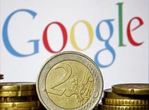 Euro coins are seen in front of a Google logo in this picture illustration taken in Zenica, April 21, 2015. REUTERS/Dado Ruvic