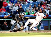 Oct 4, 2015; Philadelphia, PA, USA; Philadelphia Phillies starting pitcher David Buchanan (55) scores a run as Miami Marlins catcher Tomas Telis (11) applies a late tag during the fifth inning at Citizens Bank Park.  Eric Hartline-USA TODAY Sports