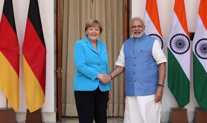 German Chancellor Angela Merkel (L) shakes hands with India's Prime Minister Narendra Modi during a photo opportunity ahead of their meeting at Hyderabad House in New Delhi, India, October 5, 2015.  REUTERS/Adnan Abidi