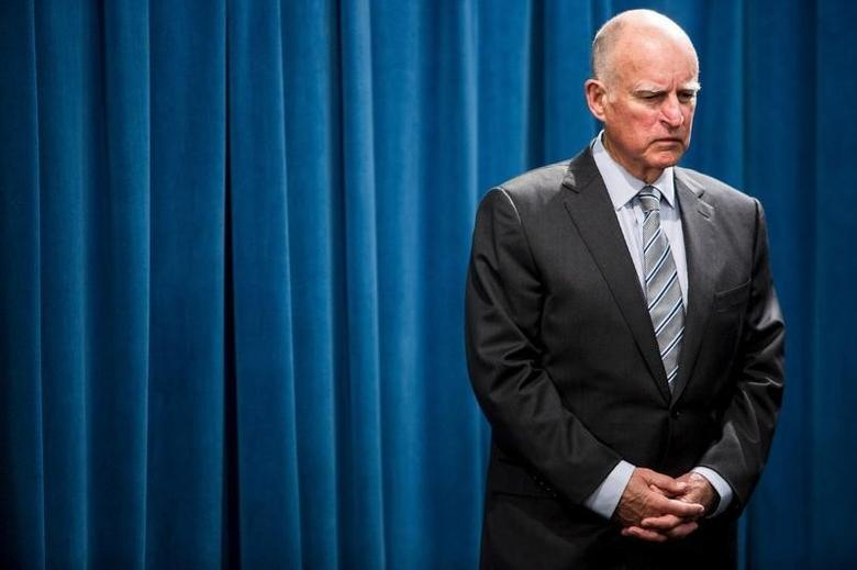 California Governor Jerry Brown waits to speak during a news conference at the State Capitol in Sacramento, California March 19, 2015, to announce a $1 billion emergency legislative package to deal with the state's devastating, multiyear drought. REUTERS/Max Whittaker