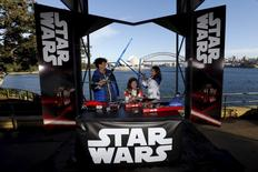 "Caleb LeBlanc (L-R) with Kayley and Annie of the Bratayley family participate in a live internet unboxing event to reveal new light saber toys from the film ""Star Wars: The Force Awakens"" in Sydney, September 3, 2015. REUTERS/Jason Reed"