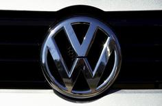 A Volkswagen logo adorns a car outside a dealership for the German automaker located in the Sydney suburb of Artarmon, Australia, October 3, 2015. REUTERS/David Gray